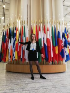 In front of EU flags