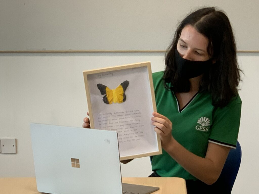 Female student presenting Butterfly Project